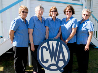 CWA ladies in front of sign