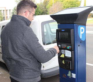 Man using pay and display machine