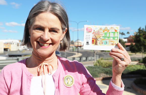 Cr Megan O'Hara Sullivan holding a Postcard for Your City Beyond 2020