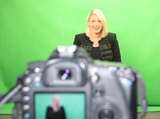 Staff member in front of green screen