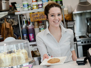Waitress serves a biscuit