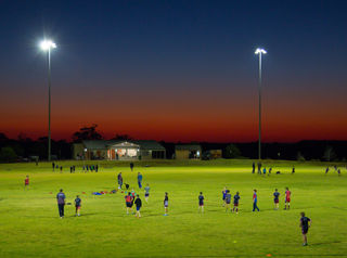 Sport field at night with players