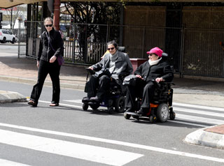 Wheelchairs on road crossing