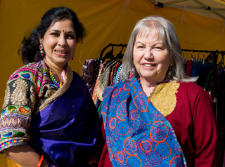Two women participants in cultural dress from Languages and Cultural Festival 2015